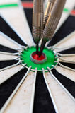 Target Bullseye. Red darts board bulls-eye target with 3 darts Royalty Free Stock Images