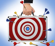 Target business brief case  with Hand and arm holding Royalty Free Stock Photo