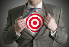 Target Businessman. A businessman pulling back his skirt to reveal a target symbol Royalty Free Stock Photography