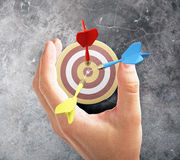 Target concept darts and hand Royalty Free Stock Image