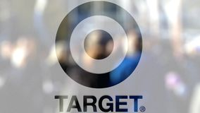 Target Corporation logo on a glass against blurred crowd on the steet. Editorial 3D rendering. Target Corporation logo on a glass against blurred crowd on the stock footage