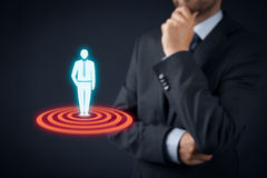 Target customer. (marketing) concept. Businessman think about  represented by virtual icon of man standing on target stock photography