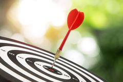 Target dart and arrow with nature background. Target dart and arrow with abstract nature bokeh blur background royalty free stock images