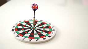 Target dart with arrow over wooden background ,abstract background to target marketing concept . Stock Image