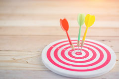 Target dart with arrow over wooden background Stock Images
