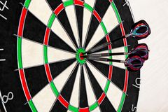 Target dart with arrows on light background, target marketing or successful business concept. royalty free stock image