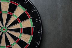 Target dart board on the black background. Center point, head to target marketing and business concept Stock Photo