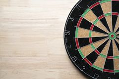 Target dart board on the wooden table background. Center point, head to target marketing and business concept Royalty Free Stock Image