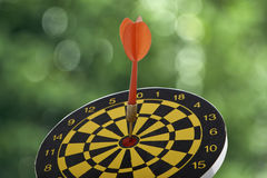 Target dart with red arrow Stock Photos