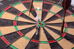 Target darts and syringe Royalty Free Stock Images