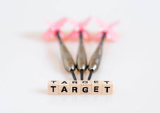Target Darts. The word target written in cube letters and 3 darts in background Royalty Free Stock Image