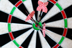 Target Darts. The word target written in cube letters and 3 darts in background Stock Image