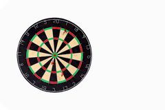 Target fail. Three arrows are not in the center of the darts on light wooden background, does not hit the aim. Concept for unsucce stock photos