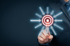 Target goal trigger. Marketing targeting, goal and trigger concepts. Businessman click on virtual target stock image