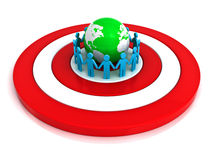Target group concept. Group of people holding hands in circle around green globe on red target with reflection over white background Stock Photos