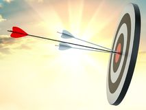 Target hit in center by arrows Stock Photo