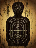 Target human silhouette with bullet holes. Human silhouette target with bullet holes over grunge background Royalty Free Stock Photography