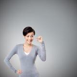 TARGET70_0_ kobieta gestykuluje małą ilość zdjęcia stock