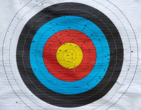 Target with many hits. Colored paper target with many hits from archery in close-up stock images