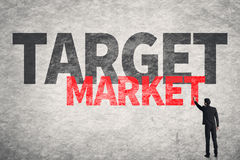 Target Market. Asian business man write words on wall, Target Market Stock Photography