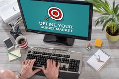 Target market concept on a computer. Man using a computer with target market concept on the screen stock photo