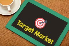 Target Market icon on chalkboard with tea cup royalty free stock photos