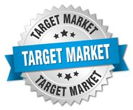 Target market. Silver badge with blue ribbon Royalty Free Stock Photography