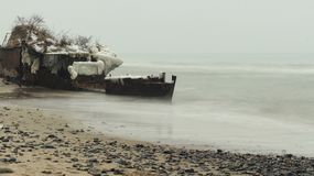 Target for military seamen. Forgotten by the time when the battle ship is located on the seashore close-up of a long exposure Royalty Free Stock Photo