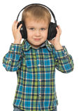 target2438_1_ muzykę chłopiec hełmofony obrazy royalty free