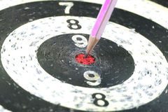 Pencil Target for business concept. The Pencil Arrow to a red target on the Dart stock photography