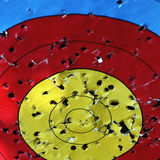 Target practice. A bulls eye target with bullet holes Stock Image