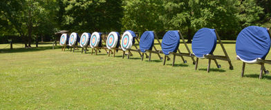Target practice. An archey training grounds located in a wooded field. Some of the targets are still covered Stock Photo