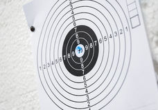 Target practice paper close-up black white blue ammo hole Royalty Free Stock Photos
