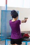 Target practicing with gun In the shooting range Royalty Free Stock Photos