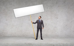TARGET100_1_ puste miejsce biały deskę uśmiechnięty biznesmen Fotografia Stock