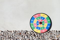Target with shoot. Colorful target with shoot on the stones with white wall behind. Right oriented royalty free stock photos