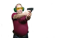 Target Shooter. A man target shooting with a 9mm pistol, over white Royalty Free Stock Photo