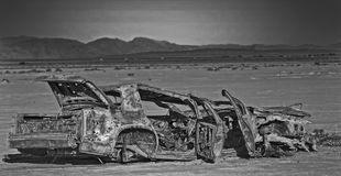 Target shooting in the desert. An old carwreck used for target shooting in the desert near las vegas Royalty Free Stock Image
