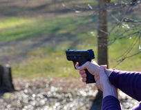 Target shooting with pistol. Target shooting outdoors with a hand gun Royalty Free Stock Images