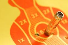 Target shooting range paper scene. Target shooting range paper with artificial pistol bullet scene Royalty Free Stock Photos