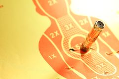 Target shooting range paper scene. Target shooting range paper with artificial pistol bullet scene Stock Photo