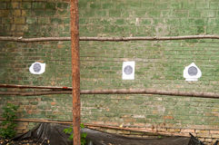 Target shooting wall. Target on the brick wall street shooting range Royalty Free Stock Photos