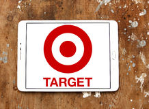 Target stores logo. Logo of the international chain of convenient stores  target on samsung tablet on wooden background Royalty Free Stock Photos