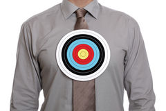 Target symbol on businessman chest Royalty Free Stock Image