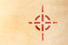 Target symbol on wood board Royalty Free Stock Images