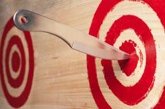 Target and throwing knife. Stock Photos