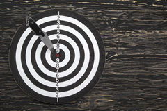 Target and throwing knife close up. Royalty Free Stock Photo