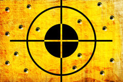 Target on the wall. With hole from shoot Royalty Free Stock Images