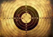 Target With Bullet Holes Over Grunge Background Stock Photo