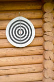 Target on wooden log wall Stock Photos